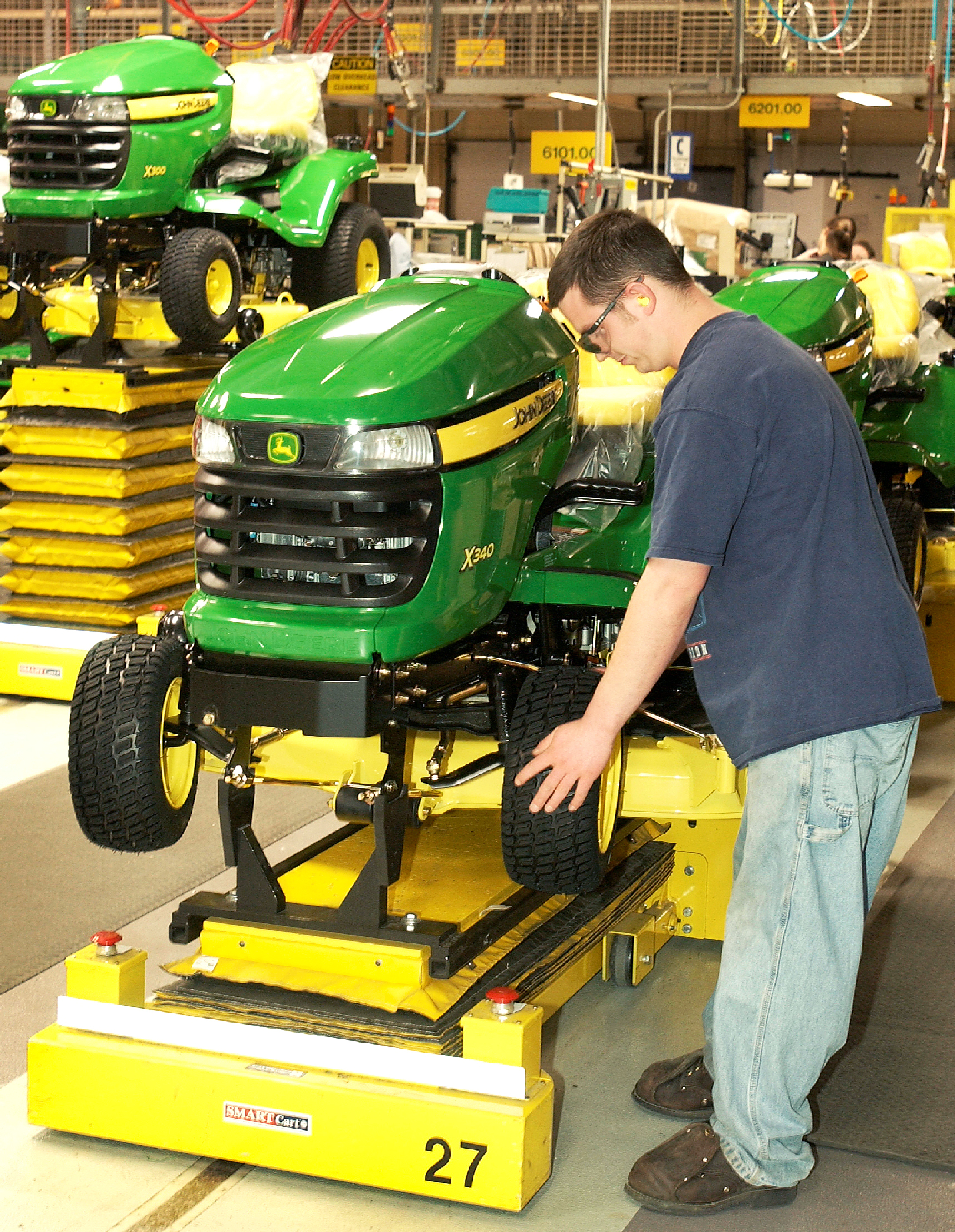 John Deere Assembly Line : Assembling assembly lines mhi solutions